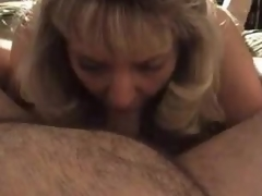Older golden-haired wife blows chubby hubby