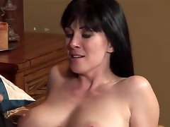 The young attractive pornstar Johnny Castle seduces his allies MILF mom RayVeness with a big natural boobies. This chab starts to kiss her lovely lips and helps to undress. They look very happy.
