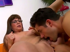 Brunette milf with long hair and glasses Alexandra Silk gets her hairy fur pie licked and fingered by a turned on stud Giovanni Francesco on the couch i the living room and enjoys