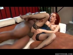Experienced curvy redhead milf Shannon Kelly with large fake balloons and bouncing ass in fishnet nylons gets her shaved minge pounded hard by tall black hunk to loud big O