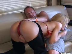 Busty aged blonde momma with large pantoons in hot cowgirl panties and red bikini enjoys in teasing her paramour and giving head on the sofa in front of the livecam