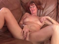 Naked solo aged redhead masturbates pussy