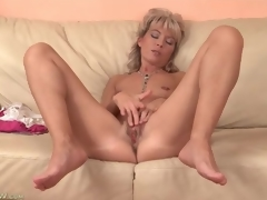 Cute mature blonde plays with her tight pussy