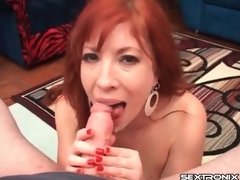 Redhead milf with arousing big zeppelins gives a handjob