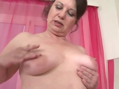 Mature caresses her large wazoo and saggy tits