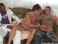Obscene granny takes 2 large cocks
