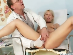 Aged Romana gynochair wet crack speculum examination by gyno doctor