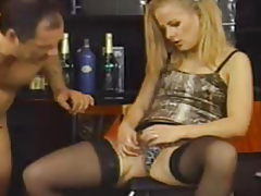 Golden-Haired in stockings fucked by a guy on a chair
