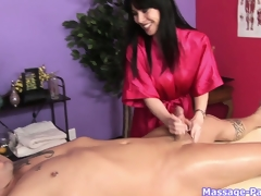 Brunette hair masseuse with big scoops works his cock like a porn star