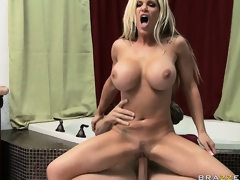 Stacked golden-haired uses her fake pantoons to rub and squeeze a big dick