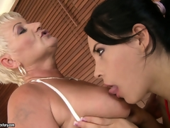 Old and young lesbians take a bubble bath and lick some shaved pussy