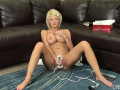 Breasty golden-haired Joslyn toys her fur pie and vibrates her clit on the couch, then receives on the floor