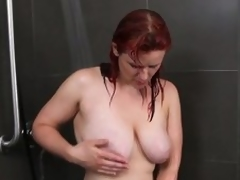Busty non-professional milf masturbates in the shower