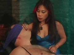 Mature Asian Dominatrix Sits Obedient Male on the Bondage Chair
